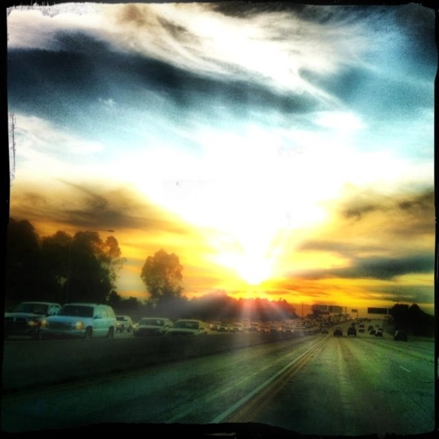sunset in traffic on the 405 freeway in los angeles
